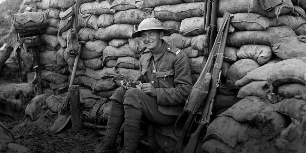 "Canadian enjoying his ""eats"" from home. July, 1917"